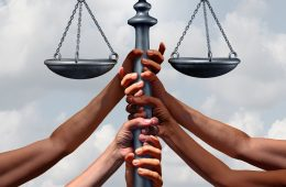Community lawyer services and law and immigration or refugee legislation and legal status as a group of people holding up a justice scale together with 3D illustration elements.